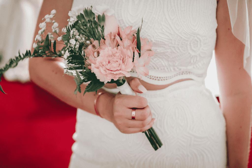 Bride in white dress holding flowers