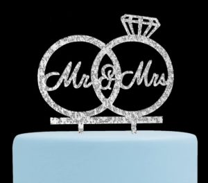 Glittery cake topper with two rings