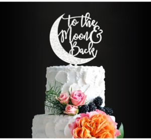 """Moon cake topper with """"to the moon and back"""" written above"""